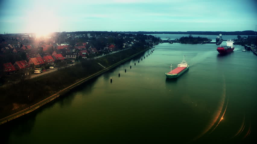 Cargo ships at sunset in Kiel Cannal, Germany, time lapse