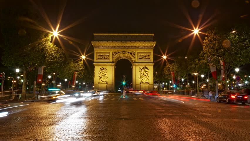Arch of Triumph at night, Paris, France, Traffic time lapse, one of the monuments of Paris, with Eiffel tower, Louvre, Montmartre, Montparnasse, Moulin Rouge, Versailles, Pompidou Center, Notre Dame.   Shutterstock HD Video #3954050