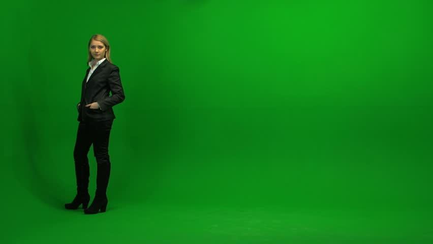 blond women walking trough frame against green screen