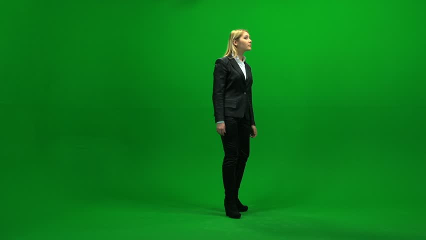 blond business women isolated against green screen