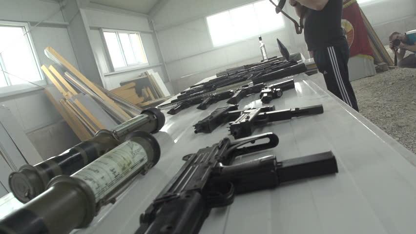 Russian weapon dealer checking AK 47