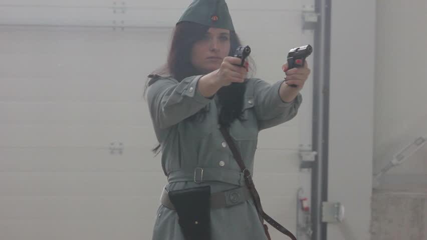 Female officer firing 2 guns