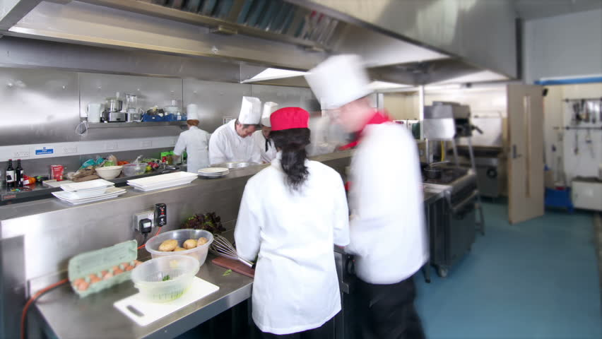 Busy Restaurant Kitchen time lapse clip of a busy team of chefs, working hard and