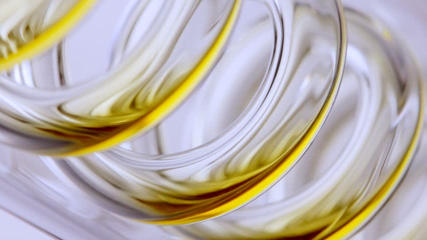 Macro HD video of biofuel processing through a laboratory condenser
