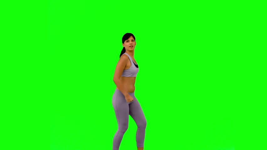 Athletic woman jumping and posing on green screen in slow motion   Shutterstock HD Video #3996880