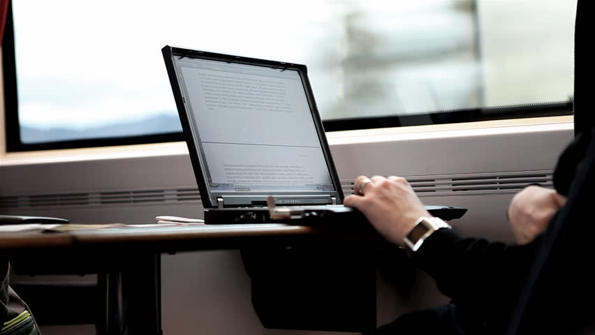 A Person is working with its Laptop during a train ride / HD1080 / 30fps