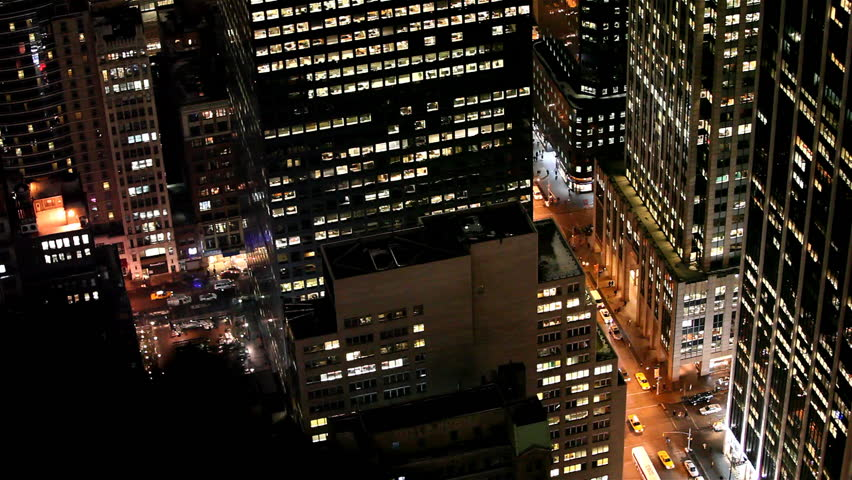 Cars follow traffic under enlighted skyscrapers in Downtown Manhattan, New York City / HD1080 / 29.97fps | Shutterstock HD Video #401296