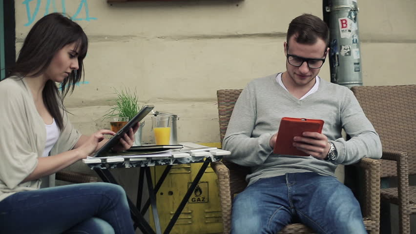 Young students with tablet computers in cafe, steadicam shot  | Shutterstock HD Video #4023124