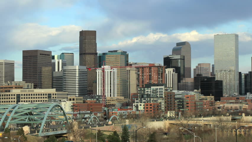 Busy afternoon traffic and skyline in downtown Denver, Colorado.  All logos