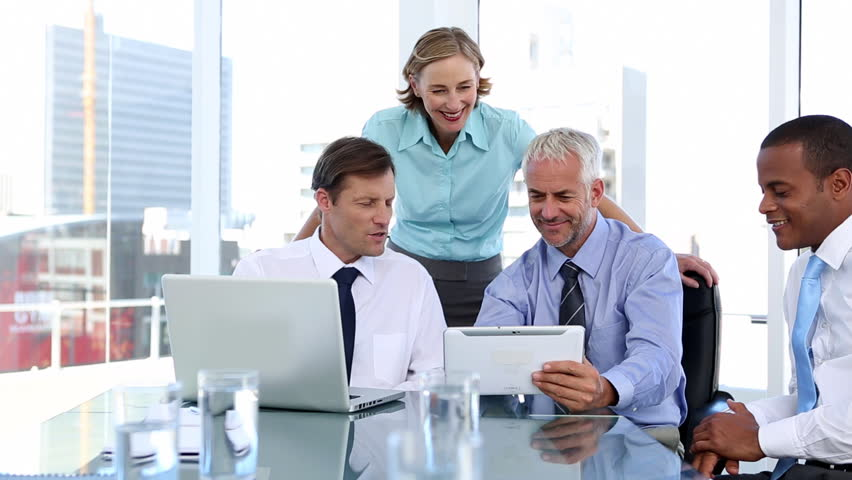 Group of business people using laptop and tablet computer during a meeting | Shutterstock Video #4051003