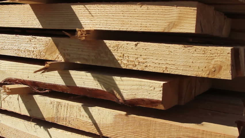 Stack of thin wood chips for house building pan/tilt shot