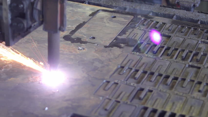 Metal plate is cut with plasma laser cutter. Heavy industry.
