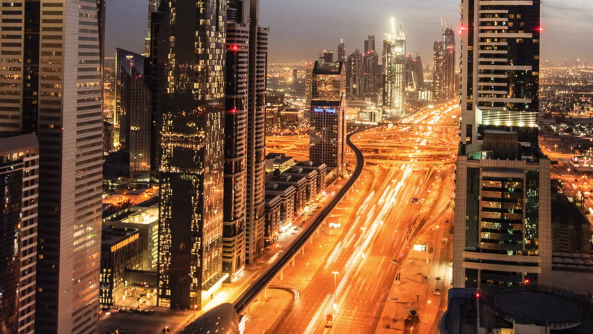 DUBAI, UNITED ARAB EMIRATES, MARCH 11th: Busy traffic scene in the rush hour on Sheikh Zayed Road, Dubai's main road artery. Transition time-lapse from dusk to night in Dubai, March 11 2011 | Shutterstock Video #4088263