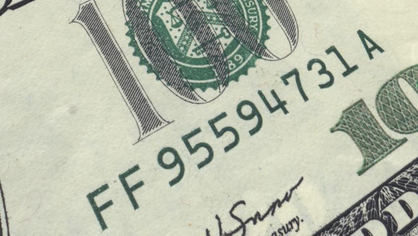 100 dollar bill money, fly over extreme macro