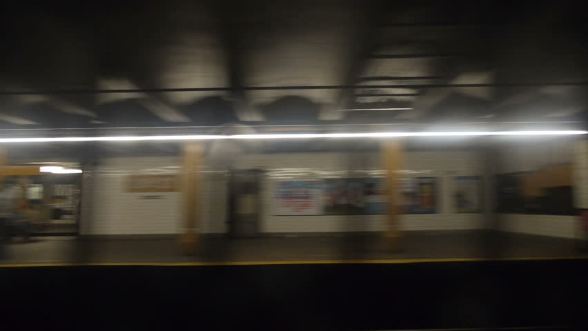 Looking out the window of a moving New York City subway.