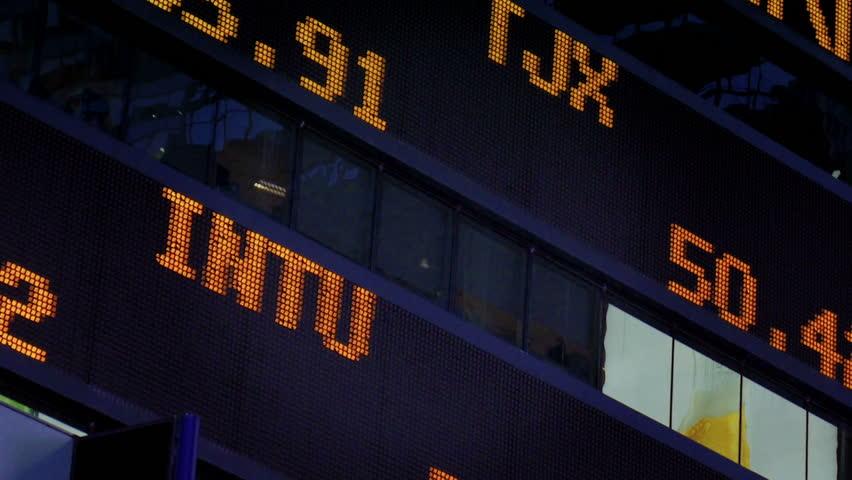 NEW YORK CITY, Circa June, 2013 - A stock market ticker in Times Square.