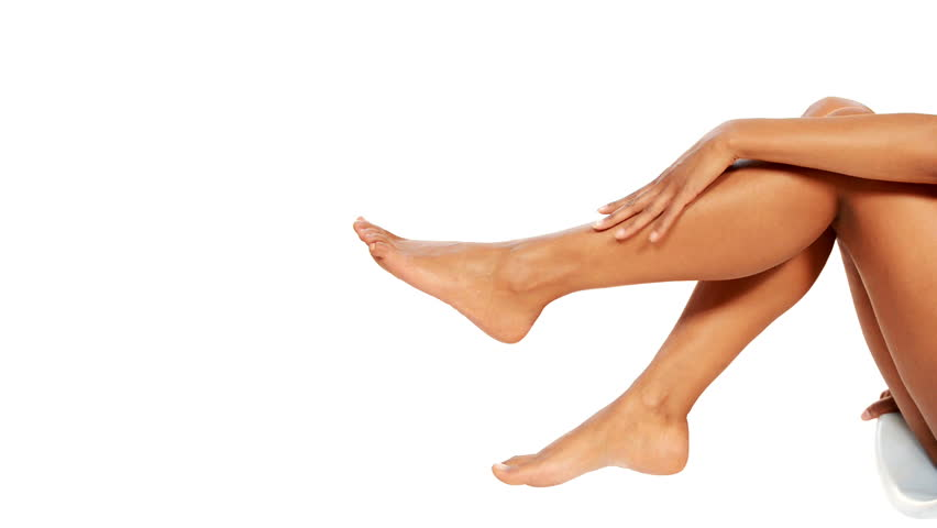Beautiful female legs isolated over white background.Beauty and skin care concept.