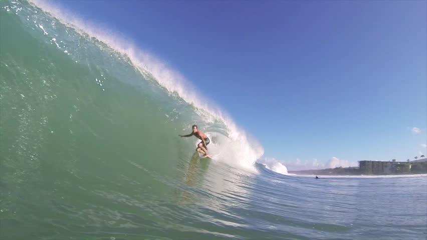 Surfer on Blue Ocean Wave Getting Barreled | Shutterstock Video #4147426