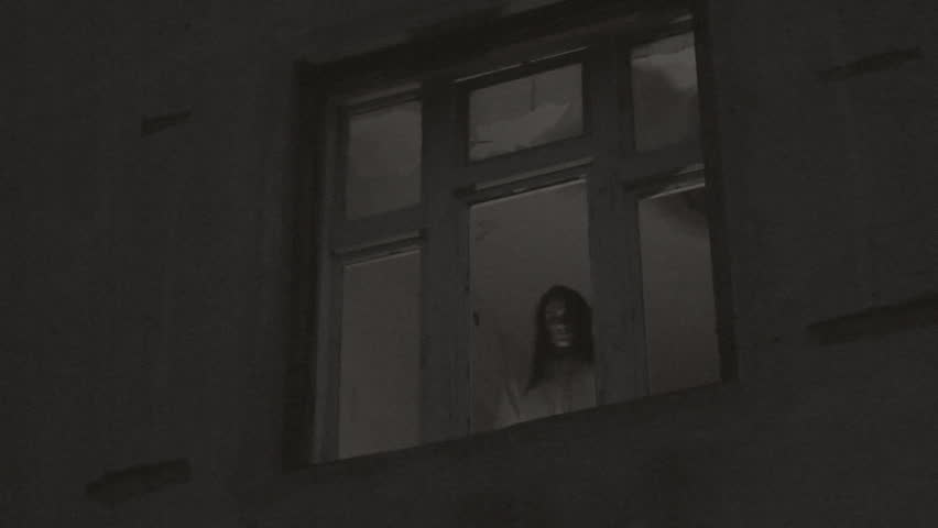 Horror Scene Of A Scary Female Ghost At The Window Stock