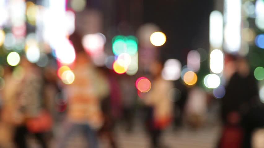 People walking in city night background. Pedestrians walking in city night with lights. Out of focus background from busy big city with people crossing street. Tokyo, Japan.   Shutterstock Video #4195021
