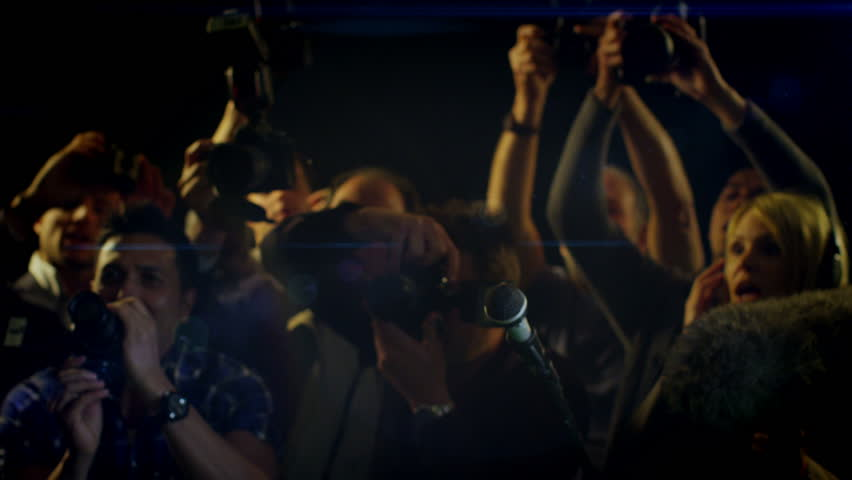 Celebrity Being Photographed By a Large Group of Paparazzi | Shutterstock Video #4208863