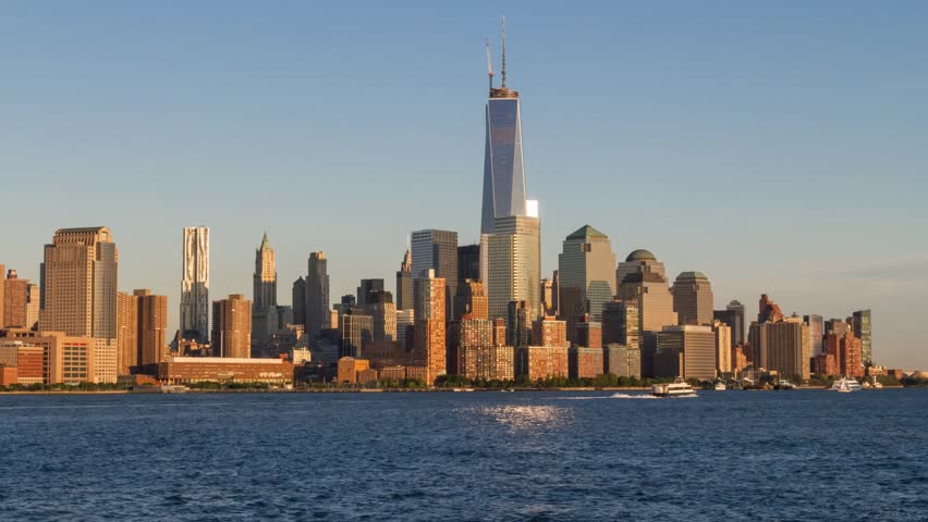 Time lapse of day changing to night over the Freedom Tower and Downtown Manhattan as seen across the Hudson River from Hoboken, NJ in June of 2013. | Shutterstock HD Video #4215370