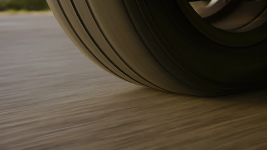 Car wheel spinning POV - Point of View, day country side.  | Shutterstock Video #4218385