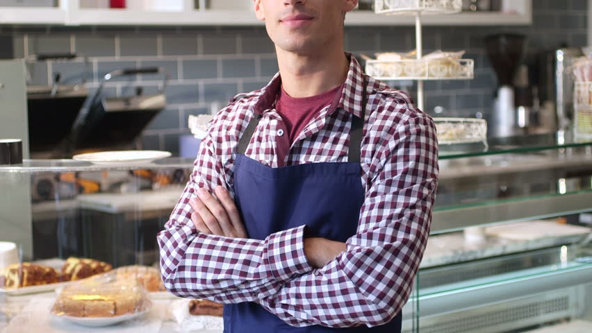 Male business owner cafe looking at camera