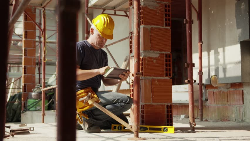 Construction worker and new house, caucasian man working with safety helmet and using digital tablet pc for data entry. Part 7 of 8 | Shutterstock HD Video #4227073