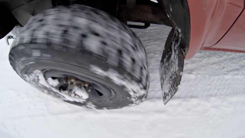 Heavy duty 4x4 tires driving through snow