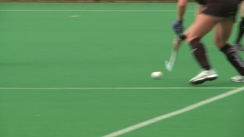 Field Hockey played on astro turf. woman's field hockey played on a rainy day in London.   Shutterstock Video #4320347