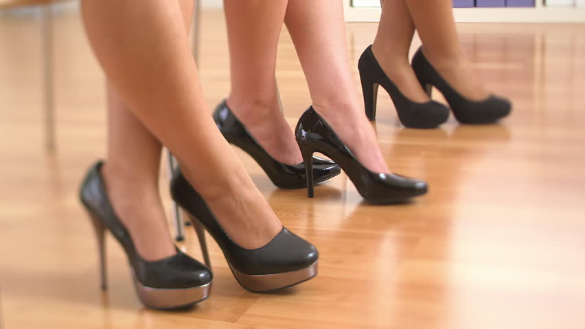 Close Up Of Three Business Women&39s Feet In High Heels Standing Up