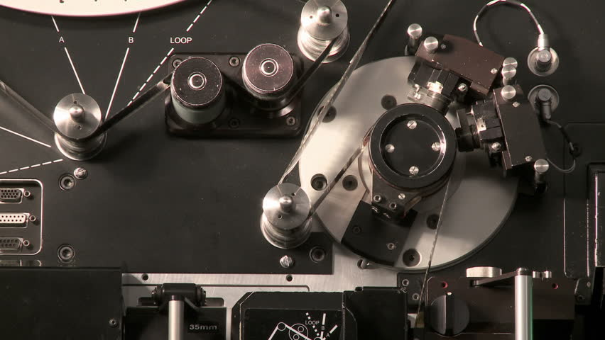 Telecine machine starting up and digitizing 35mm film in a movie post production