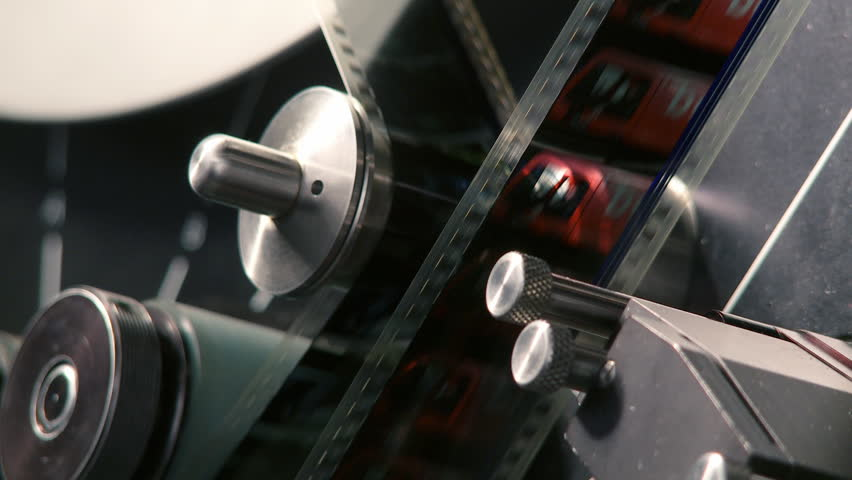35mm film moving through a telecine machine, which digitizes the images and