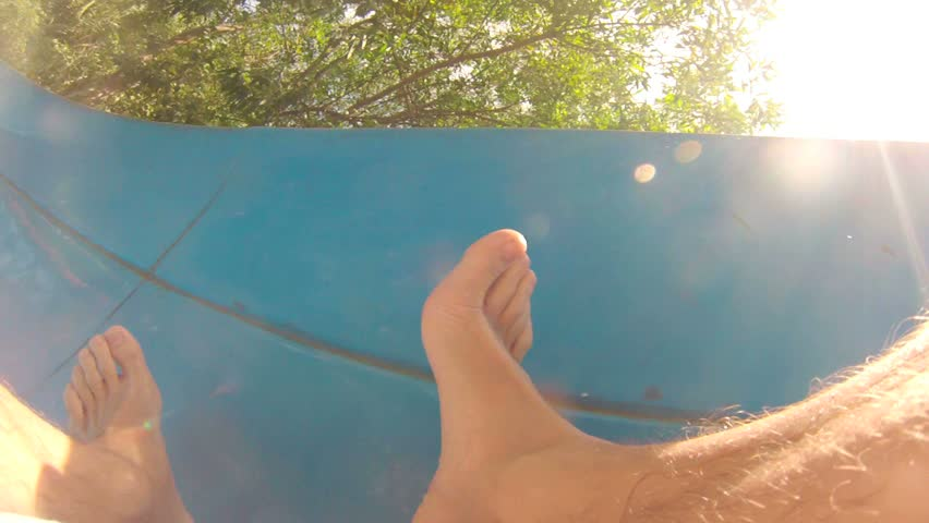 Rider's perspective of sliding down a water slide.