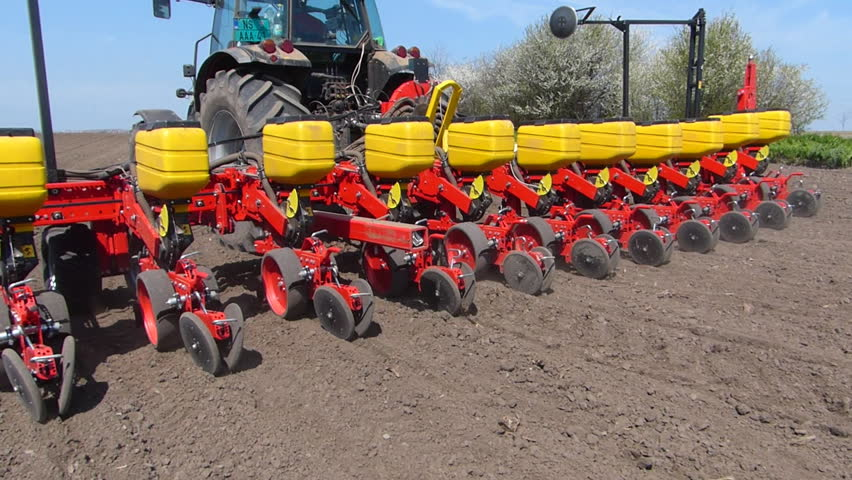 Tractor In Field Planting : Tractor and seeder planting crops on a field stock footage