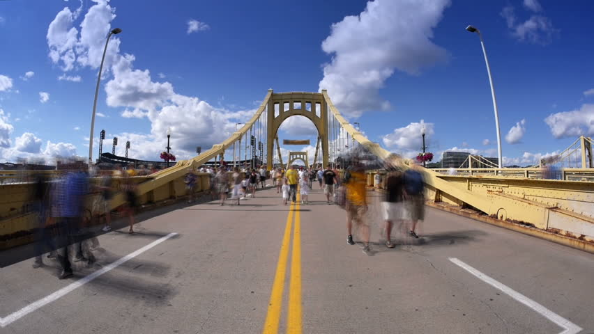 A time lapse view of Pittsburgh Pirates fans walking over the Roberto Clemente