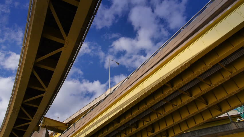 Looking up at the steel beams and girders of the Fort Duquesne Bridge over the