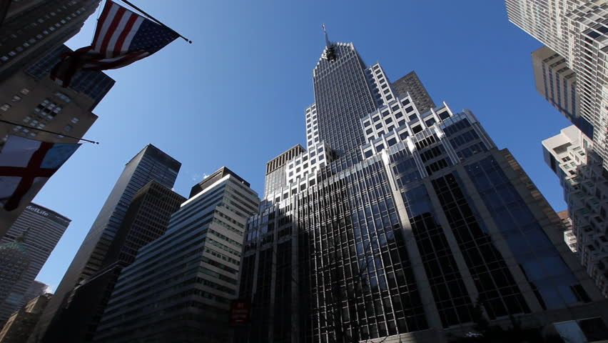 Pan over New York City buildings in front of dark...