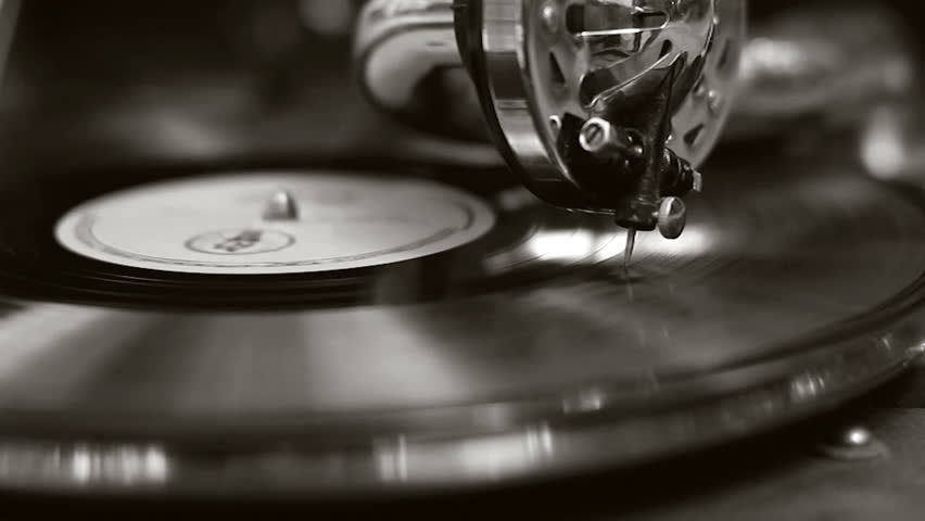 Black and white old movie retro gramophone. Vintage turntable big needle, vinyl