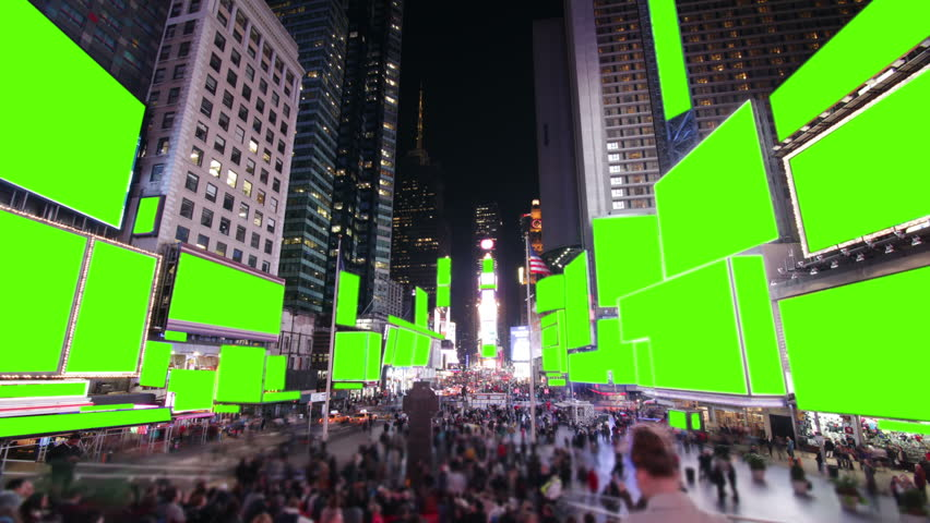 Time lapse of bustling crowds and traffic and the famous advertising billboards at Times Square, New York. With green screen for your own messages.