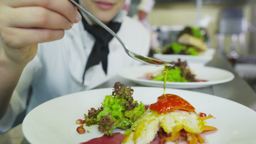 A delicious gourmet meal is being given the finishing touches by the chef in a restaurant or hotel kitchen, ready for service to the customer. | Shutterstock Video #4448807