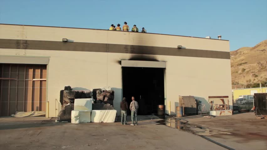 Firefighters fighting a warehouse fire