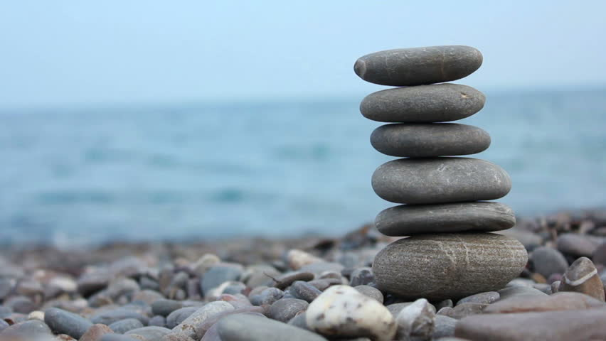 Set Of Three Zen Stones Stacked And Balanced Top Of Each Other On ...