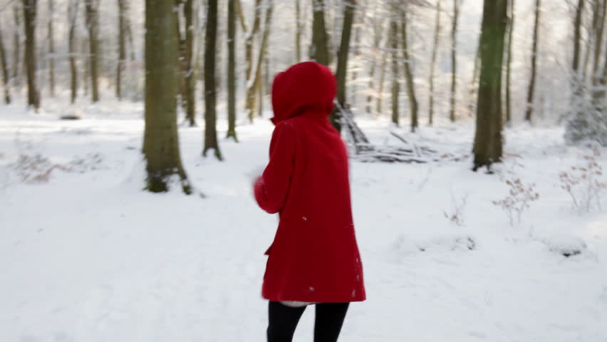 Little Red Riding Hood - Young Girl In Red Coat Stands Out Against