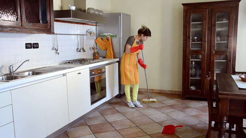 young woman cleaning kitchen counter and stove stock footage video
