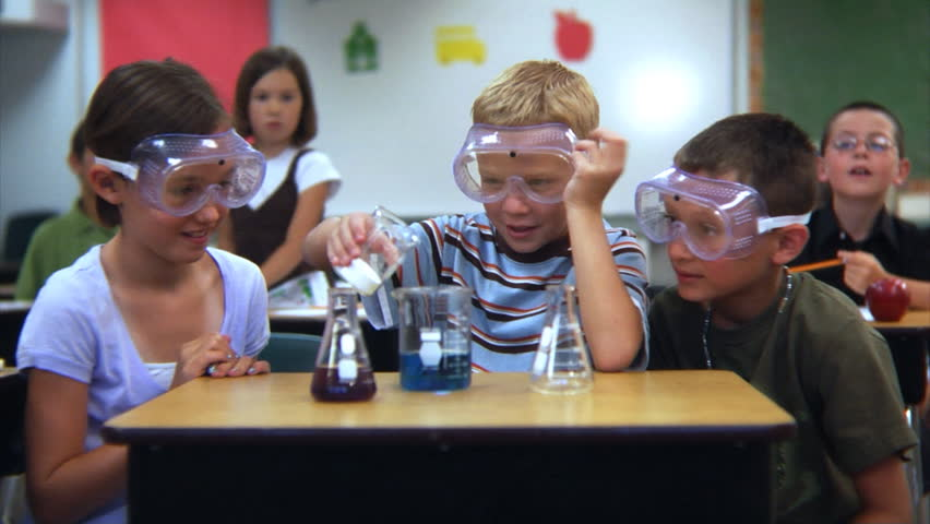Elementary school students doing a science experiment   Shutterstock HD Video #4541198