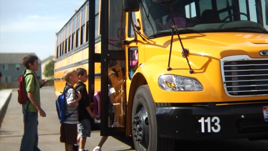 Students getting on school bus   Shutterstock HD Video #4541216