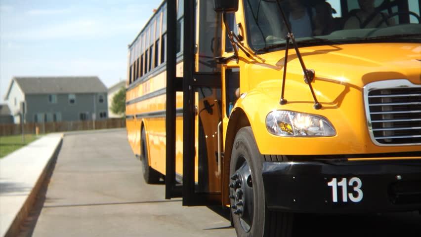 Students getting off school bus   Shutterstock HD Video #4541231