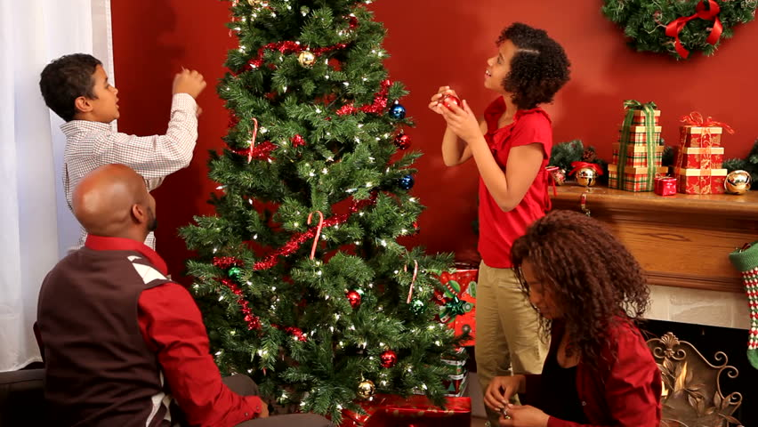 Lovely Family Around Christmas Tree Part - 4: Family Decorating Christmas Tree Together